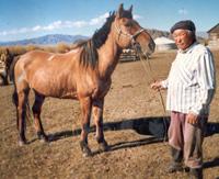 Иван Данзырын с любимым конем Кула-Даем